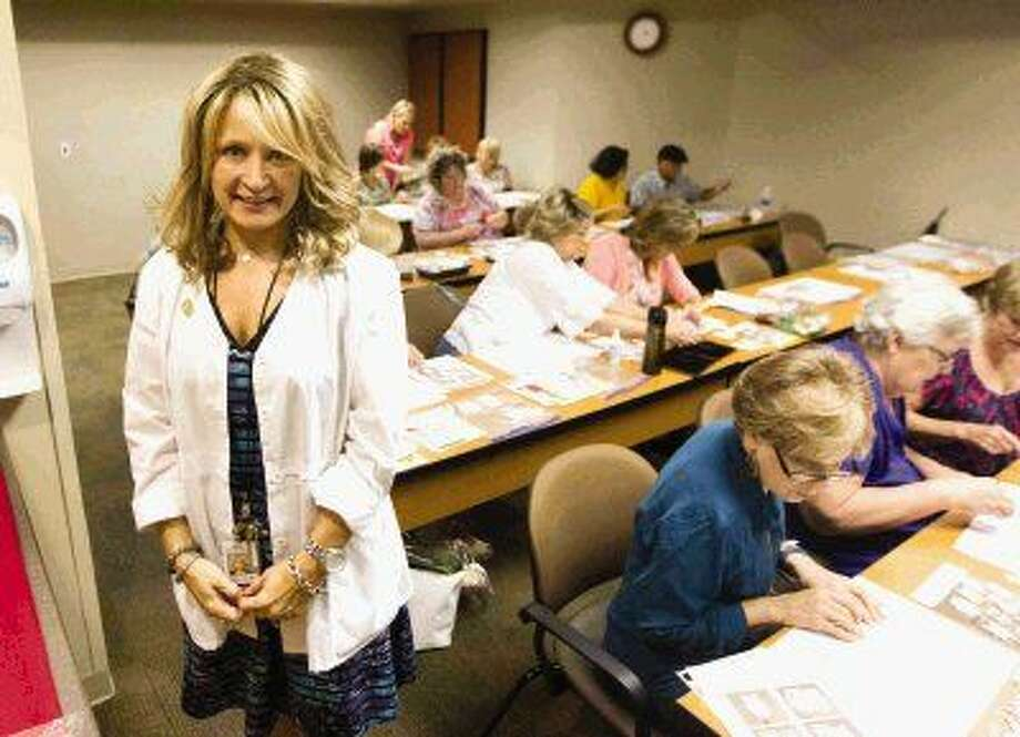 Carolyn Allsen, left, started the art therapy group at Memorial Hermann The Woodlands Hospital for cancer patients and survivors, as well as caretakers.