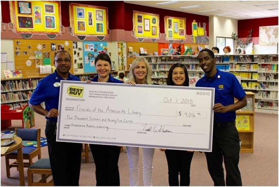 From left, From left to right: Theron Lawry, general manager at Best Buy Atascocita; Claudia Washington; community events coordinator, employee experience team captain at Best Buy Atascocita; Dawn Mehan - children's librarian at Atascocita Branch Harris County Public Library; Jessica Espino, employee experience team treasurer at Best Buy Atascocita; and Deante Knighten, employee experience team co-captain at Best Buy Atascocita.