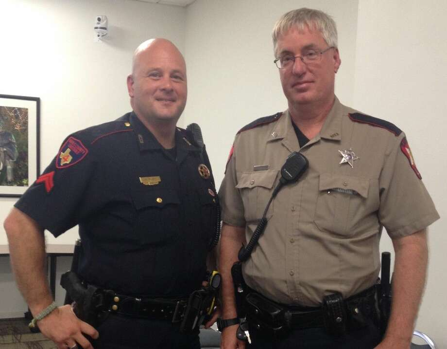 Corporal Mike Ruby, left, with the Harris County Precinct 4 Constable's Office, and Deputy Jason Hopper, an officer with the Montgomery County Sheriff's Office, shared crime prevention tips at Watch Talk Wednesday.
