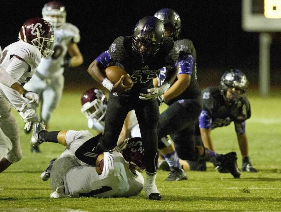 Willis running back Bryston Johnson runs the ball during a football game Friday.