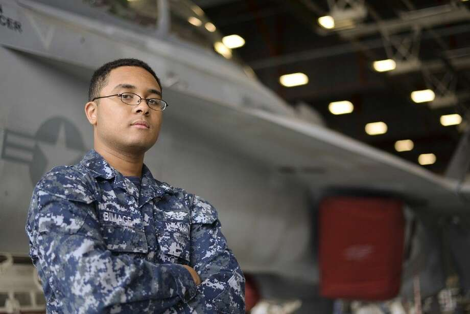 Petty Officer 3rd Class Darius Bimage is an avionics technician with VAQ-130, a Whidbey Island-based squadron that operates the Navy's newly designed electronic warfare aircraft, the EA-18G Growler. Photo: Submitted Photo