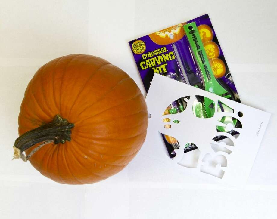 Purchase a large Jack-o-lantern pumpkin with at least one side that's good for carving. Most places that sell pumpkins also sell carving kits with tools and patterns if you need them.