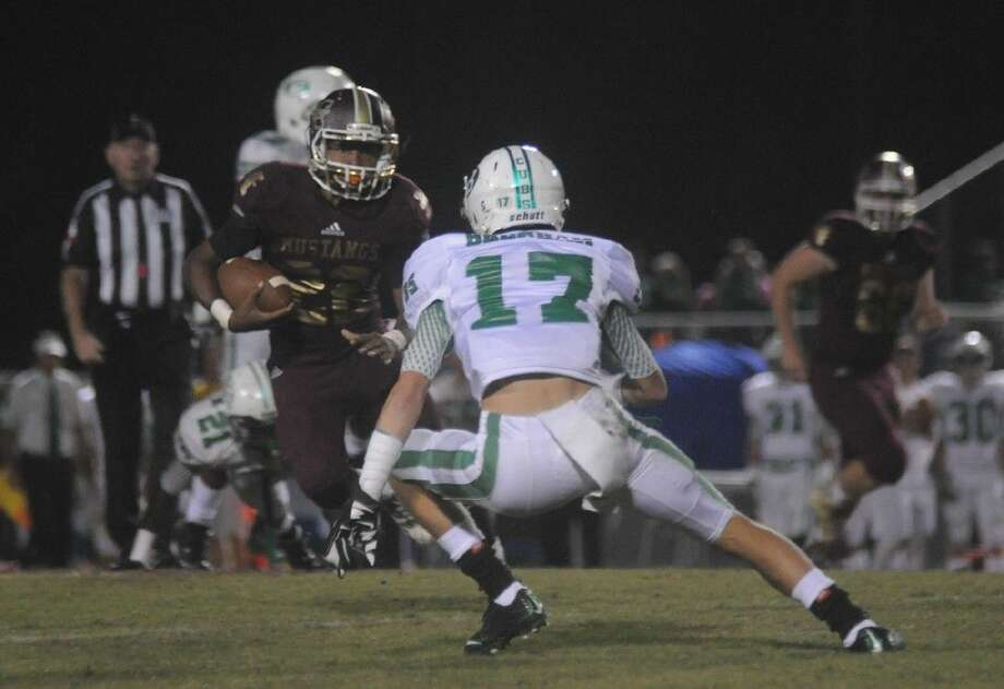 Magnolia West's Adrian Thomas makes a move on a defender against Brenham at Mustang Stadium on Friday in Magnolia. Photo: Keith MacPherson