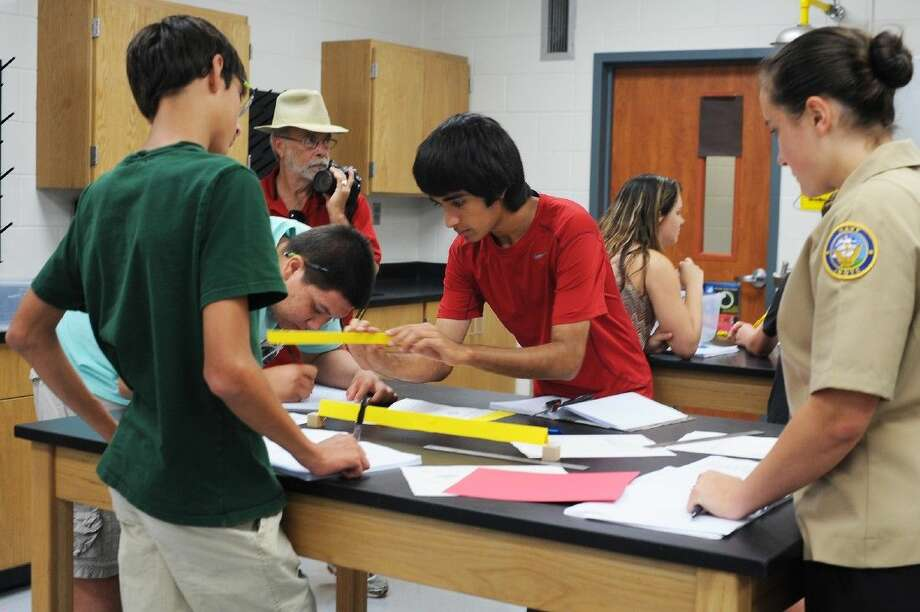 Students work together to build a bridge. From left are Santiago Perez-Isaza, Nicolas Puebla, Andrew Sanchez and Cheyenne Smith. Photo: Tony Gaines