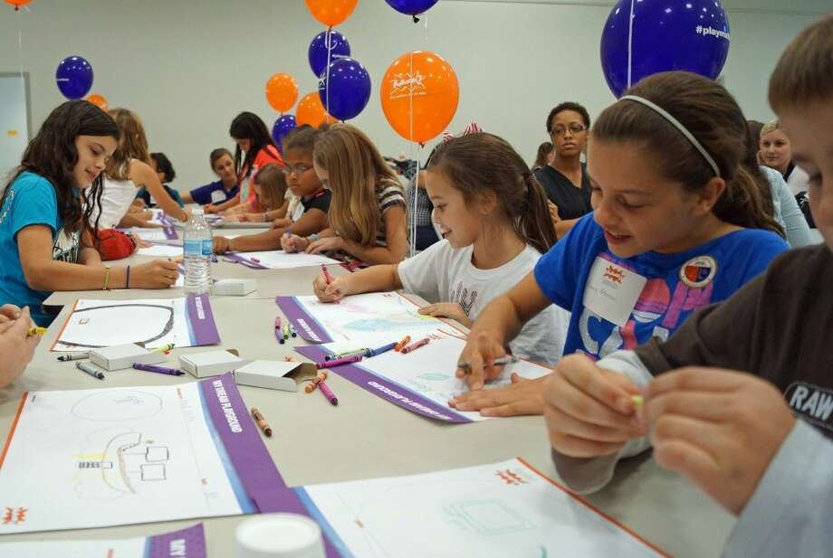 """More than two dozen children from Tomball area elementary schools took part in the recent KaBoom! design day activity to help determine their """"perfect"""" playground to be built on December 6th at the new Broussard Community Park in northeast Tomball. Photo: Submitted"""