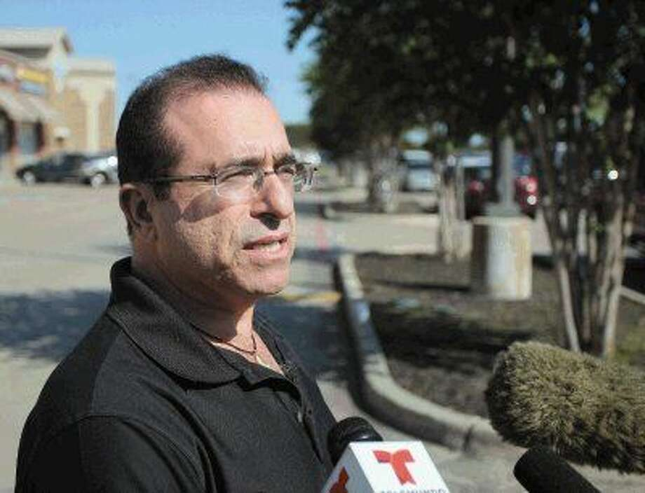Moshe Allon, owner of Immediate Medical Care talks with media in front of his urgent care facility at 2640 East League City Parkway Thursday afternoon after a patient visiting West Africa became sick and showed symptoms of Ebola. The patient later tested negative for the disease. Photo: Kar B Hlava