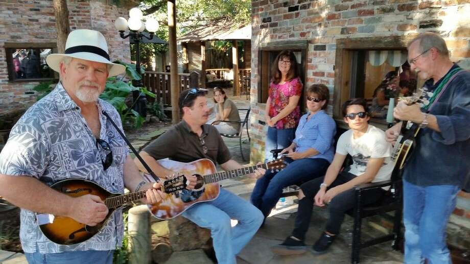 """Shade Tree Jam"" pickin' party at the Tomball Bluegrass Festival. Photo: Submitted"