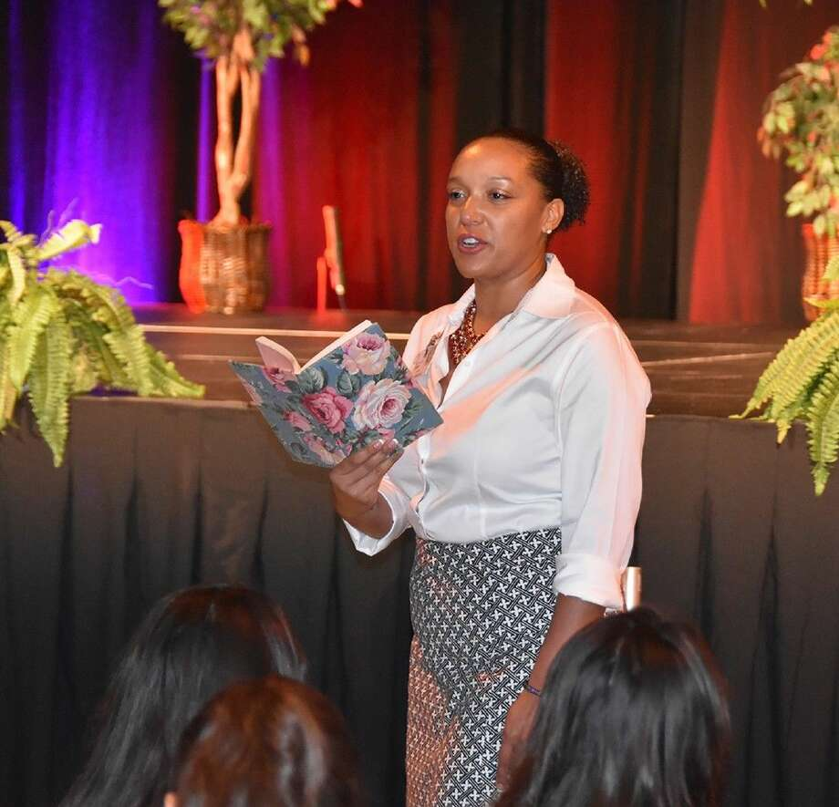 Cypress Ridge teacher Soul Singh reads an entry from her diary as a child to ninth-grade students at the Regal Rams Freshmen Summit at the Berry Center.