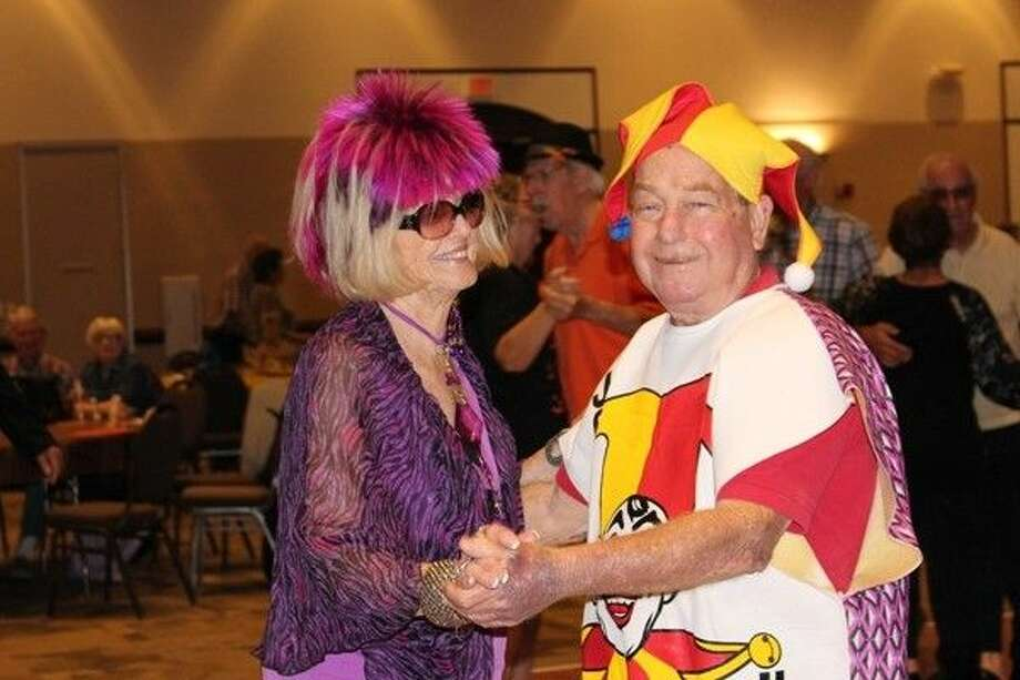 Mary Ringlaben dances with John Rasmussen at last year's Harvest Moon Dance.