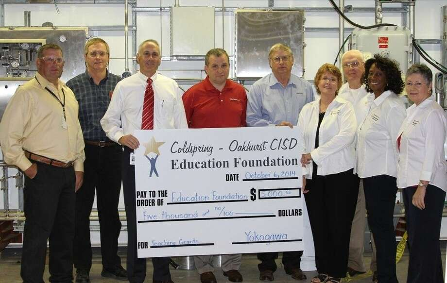 Representatives of Yokogawa, Inc. gathered at the Coldspring location to show its support of the Coldspring-Oakhurst CISD Education Foundation on Monday, Oct. 6. Pictured from left to right are Yokogawa, Inc. Production Manager Scott Eddleman, General Manager John Williams, Chief Operating Officer Daniel Duncan, Division Manager Keith Linsley, Sales Manager Ron Eddleman, COEF President Pat Clark, VP of Finance & Governance Robert Holton, VP of Programs Judy Joseph and VP of Development Sue Thomas. Photo: Cassie Gregory