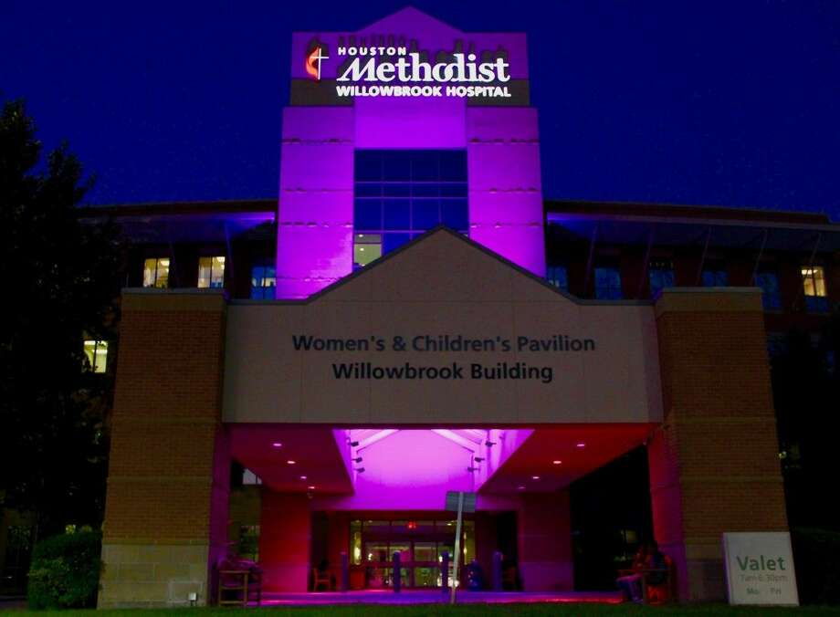 The Women and Children's Pavilion and North Pavilion are lit pink this month at Houston Methodist Willowbrook Hospital in honor of Breast Cancer Awareness Month. Photo: Vagney Bradley