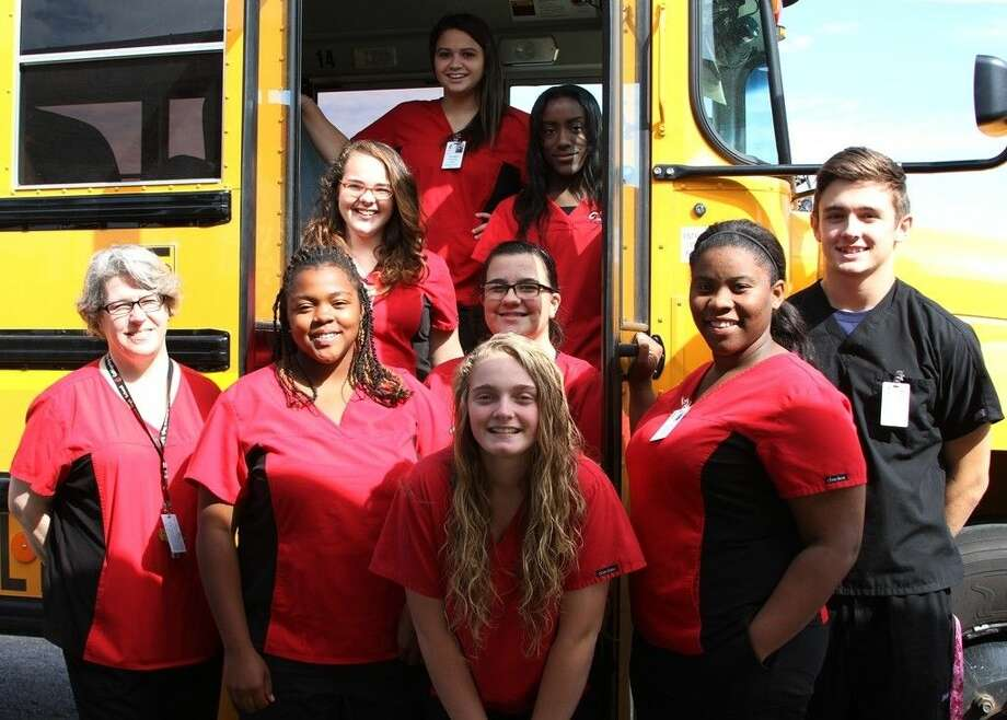 Coldspring-Oakhurst High School CNA students board the bus headed for their rotations at St. Luke's Memorial Medical Center-Livingston. The class visits the hospital twice a week as part of the COHS Certified Nursing Assistant program. Pictured are Krysta Jordan, Taylor Kelly, Katlin James, CTE/Health Science teacher Susan Caraballo, Staniquia Phipps, Willow Reid, Keyanna Billard, Andrew Harrison and Kaytlynn Blalock. Photo: Cassie Gregory