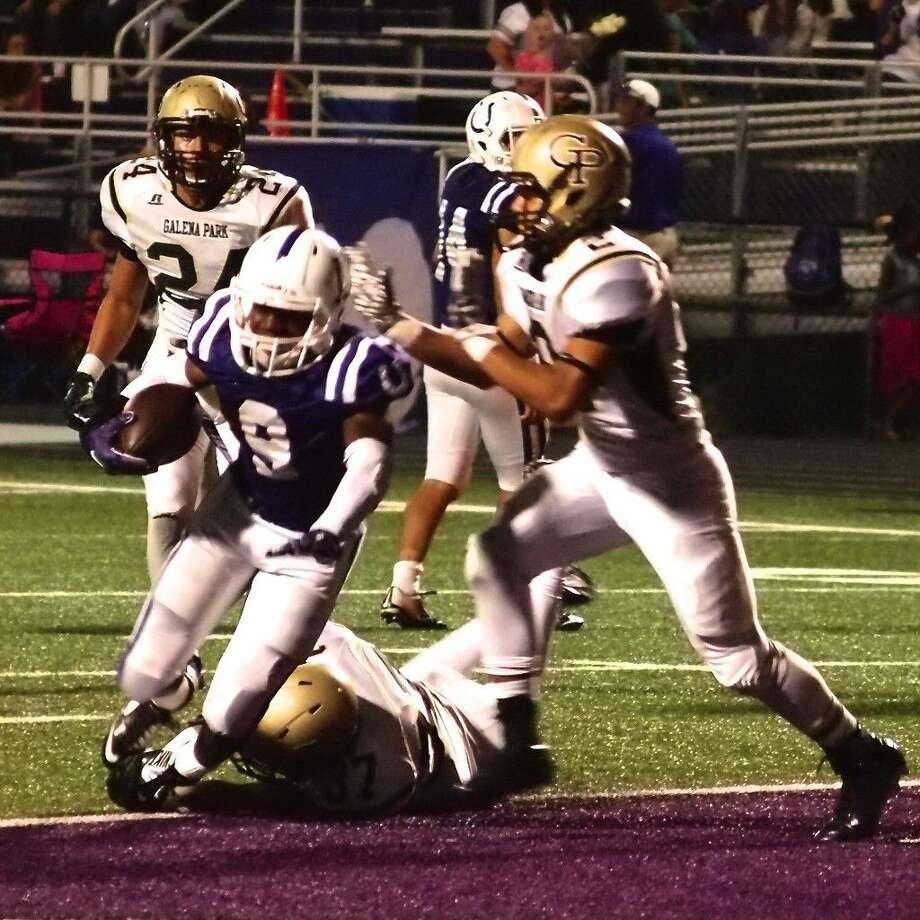 Dayton running back Jalen Styner scores in the second quarter of the Broncos' homecoming game against Galena Park, Oct. 2, 2015. Photo: Casey Stinnett