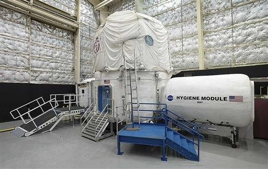 The space agency, which is contemplating a future journey to Mars, is working with a military laboratory at the submarine base in Groton, Conn., to measure how teams handle stress during month-long simulations of space flight. Photo: Bill Stafford