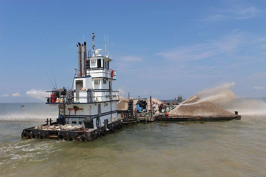The tugboat Diamondback pushed two barges filled with cultch to the reef site.