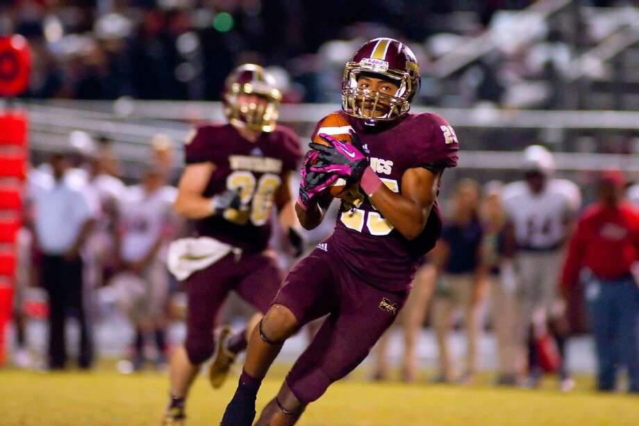 HCN photo by Tony GainesMagnolia West's Adrian Thomas had touchdown receptions of 65 and 13 yards and a scoring run of 60 yards in the Mustangs' 61-50 loss to Pearland Dawson. Thomas is The Courier's Player of the Week.