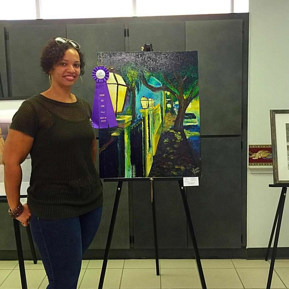 Mark Twain art teacher, Lauren Luna, with her Best in Show oil painting at the Pearland Arts League Show.