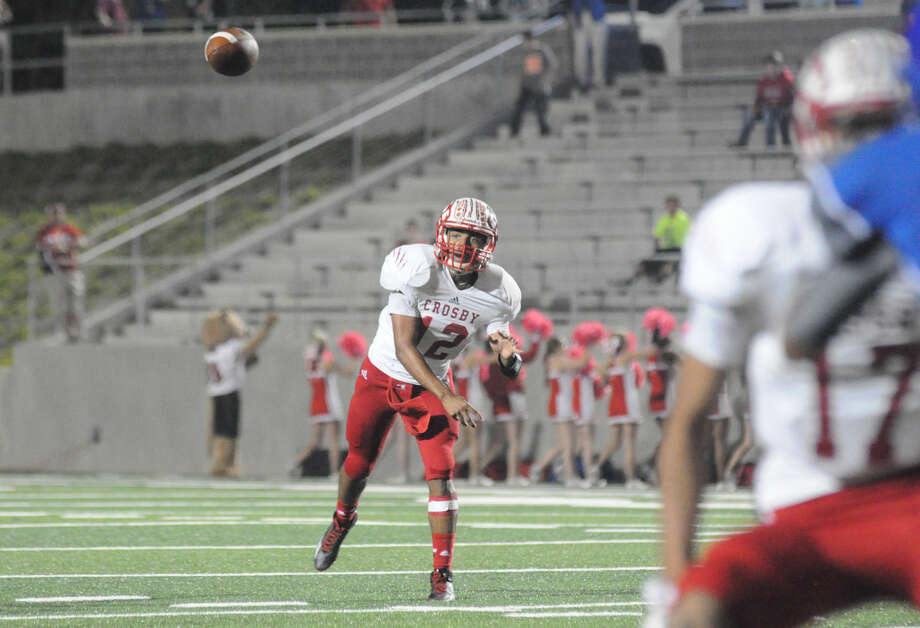 Crosby's Tristen Cotton fires a pass against New Caney at Texan Drive Stadium on Friday. Photo: Keith MacPherson