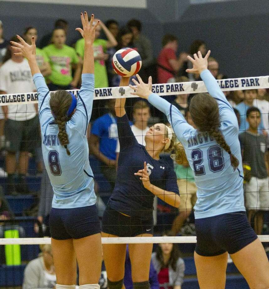 College Park's Macey Rabson gets a shot past Kingwood defenders Madison Brabham, left, and Sophie Zielinski on Friday.