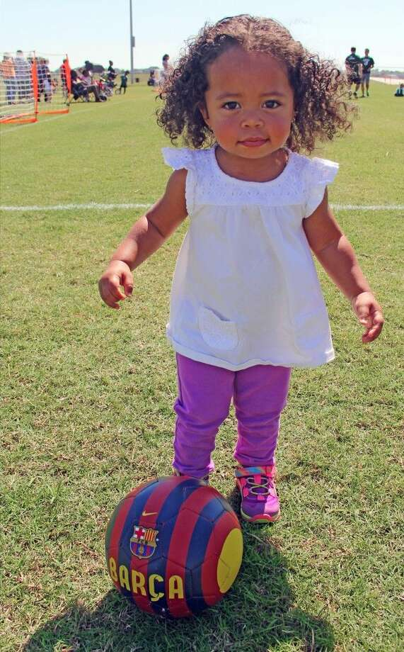 One-year-old Parker Cathus honed her soccer skills on the sidelines during her big sister's game. Photo: Kristi Nix