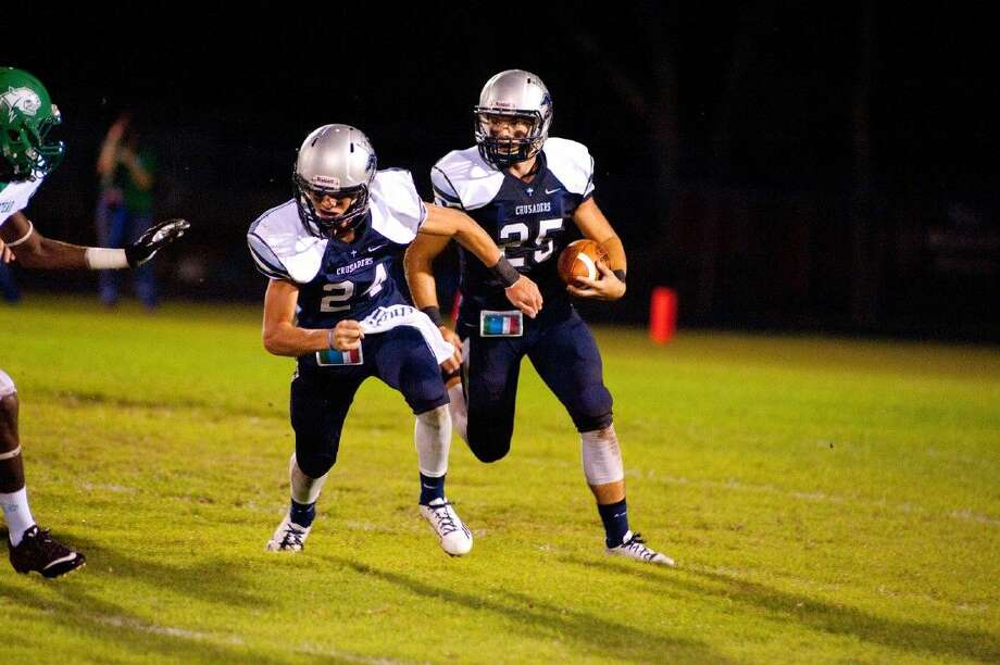 Concordia Lutheran running back Zach Huwyler (25) runs the ball with running back David Brandenburg (24) leading the way with a block against Hempstead on Friday in a 42-41 loss.