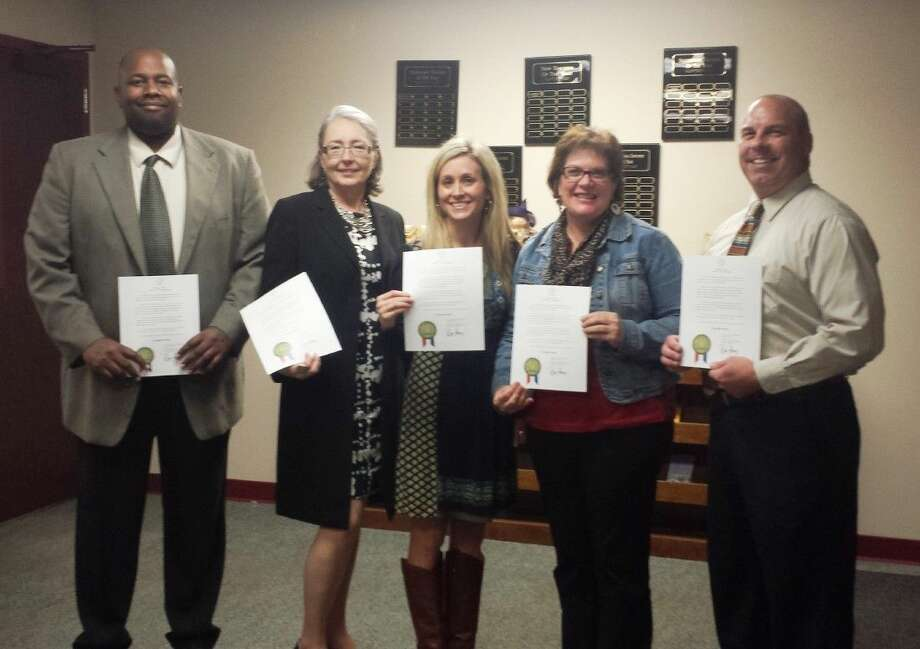 Splendora ISD campus leaders, including SHS Principal Dr. Nate Session, Splendora Jr High Principal Kent Broussard, Greenleaf Elementary Principal Dr. Carolyn King, Peach Creek Elementary Principal Julie Gillespie and Piney Woods Elementary Principal Luci Schulz, were recognized during the Oct. 20 school board meeting. The recognition was offered as part of a proclamation given by Texas Governor Rick Perry, designating the month as Principal's Month. Photo: Stephanie Buckner