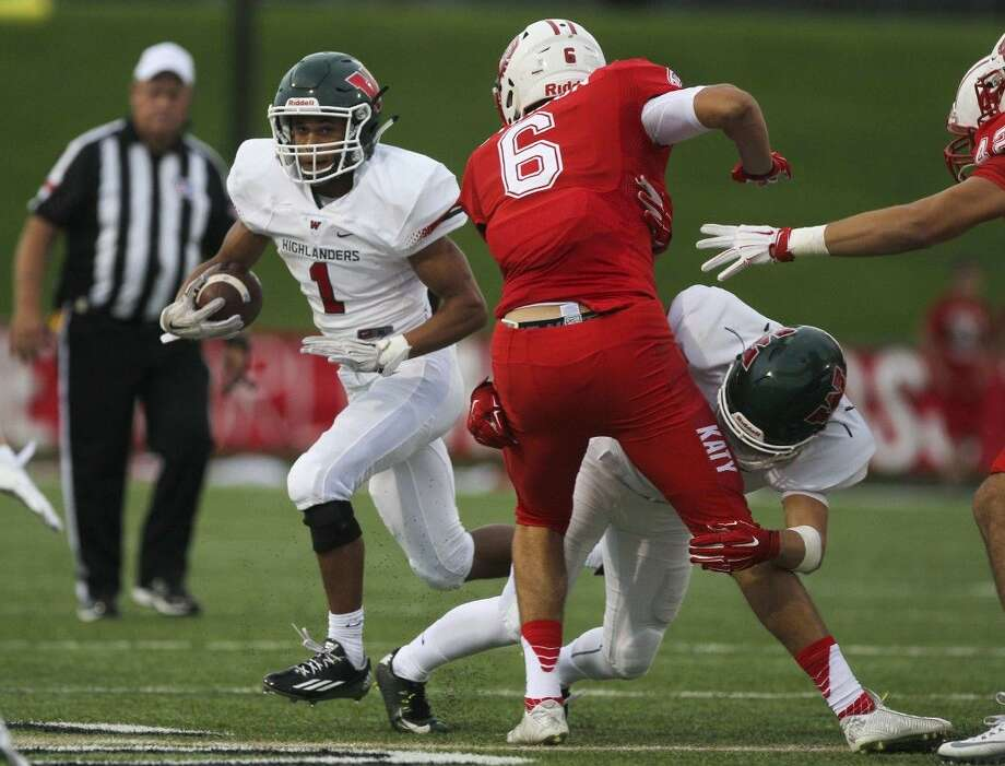The Woodlands wide receiver Christopher Stewart runs the ball during the first half of a high school football game Friday at Katy's Hughes Stadium. A few hours later, Courier Sports Editor Jim Mashek got locked up inside the stadium.