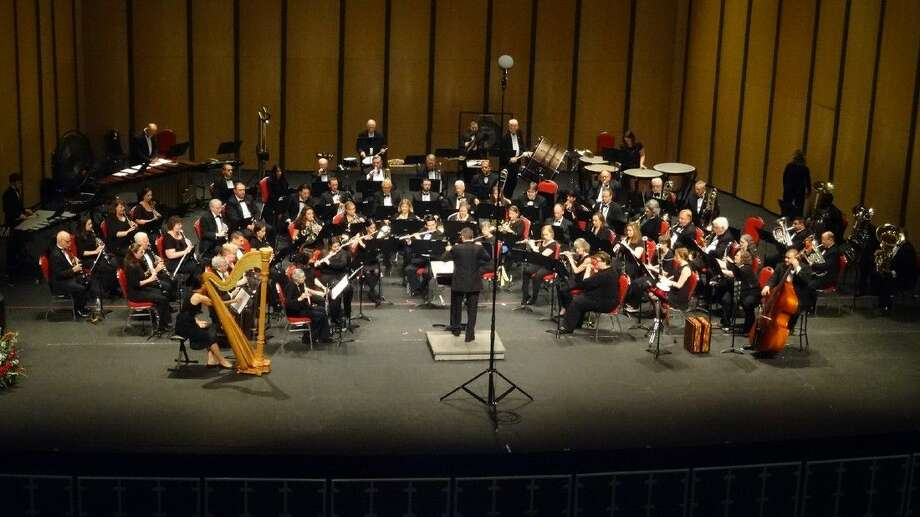 The Lone Star Symphonic Band performs at the Lila Cockrell Theatre in San Antonio as part of the 2015 Texas Bandmasters Association Convention. They will be performing a Katy Heritage Concert on October 18. Photo: Dennis D Beckmann