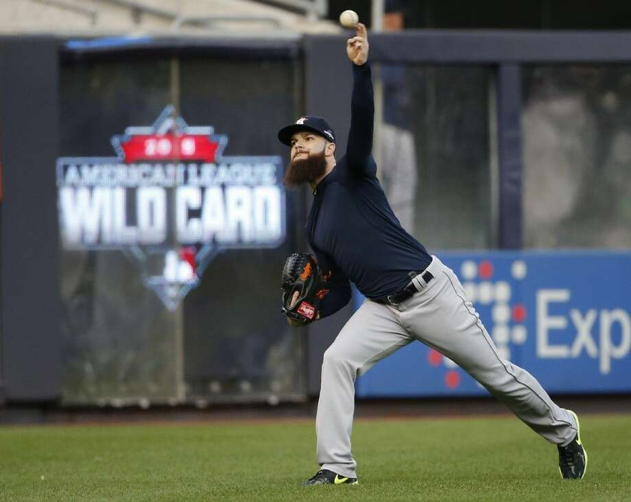 Astros left-hander Dallas Keuchel warms up before the team's practice at Yankee Stadium on Monday. The Astros face the storied New York Yankees in a one-game AL wild-card game tonight in New York.