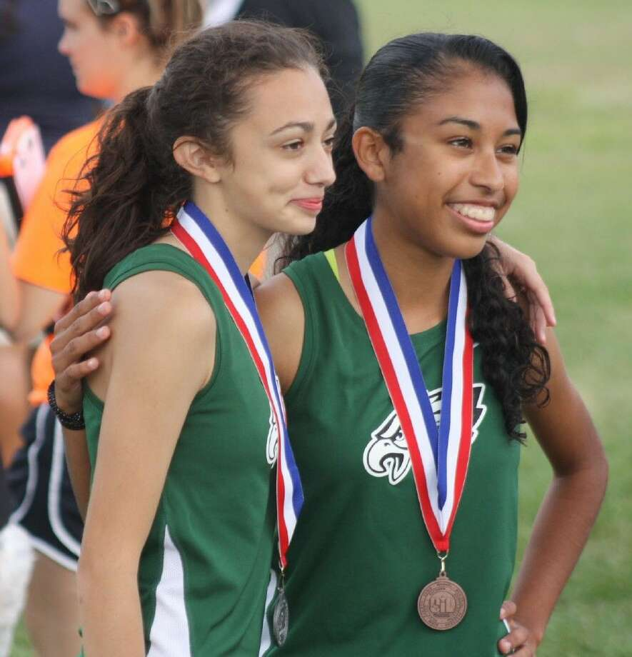 Pasadena's D'Israel Cardona (left) and Liliana Zapata, are bound for regionals after they captured the second and tenth-fastest 5000-meter times at the 22-6A meet. Photo: Robert Avery