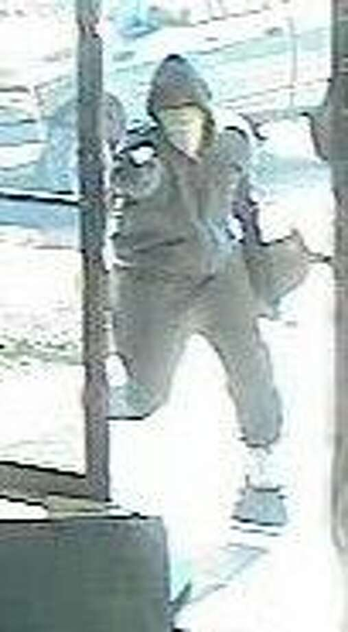 Surveillance photograph of one of two robbers released by the FBI.