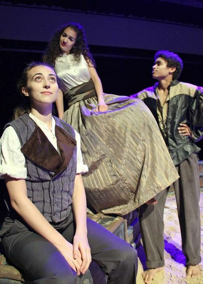 "A strange love triangle ensues in Dawson High School's production of ""Twelfth Night"" as Orsino (Antonio Lasanta, far right) falls for Lady Olivia (Rola Elkhatib, middle), who in turn falls for his disguised pageboy Cesario (Lauren Bass, far left)."