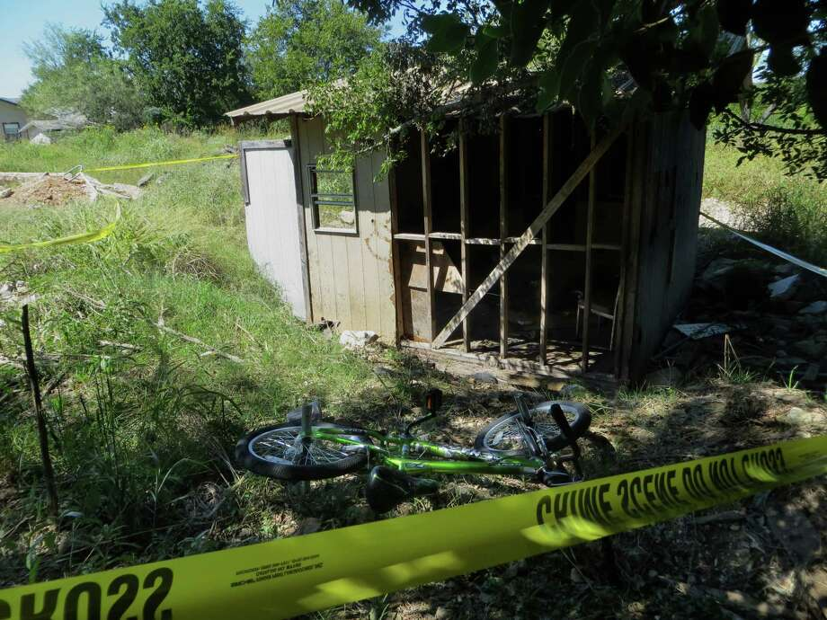 Kayden Culp's bicycle lies next to the shed where he was burned while playing with other children Sunday in Kerrville. Kayden, 10, was at a University Hospital after suffering second degree burns over 20 percent of his body. Authorities are investigating the incident. Photo: /Zeke MacCormack / San Antonio Express-News