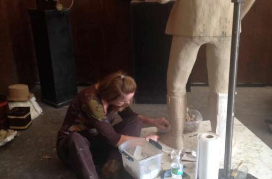 Lori Betz sculpts the clay she will use to make the mold. Betz's finished statues will be on display at the Clayton Library Center for Genealogical Research on Monday, Oct. 26 from 4 p.m. to 7 p.m.