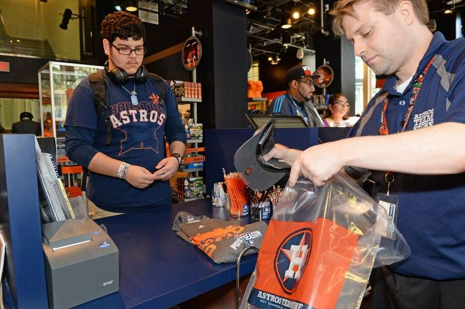 Jesus Venegas purchases his Astros postseason t-shirt at the Astros team store on Monday, October 5. The store was open for 24 hours from immediately following Sunday's finale until Monday evening.