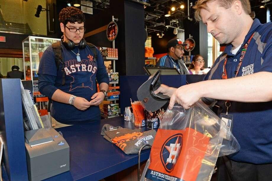 b370ba11cec02 Jesus Venegas purchases his Astros postseason t-shirt at the Astros team  store on Monday