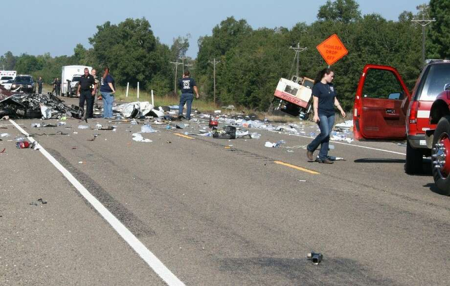 Debris is strewn across SH 105 following a three-vehicle accident on Tuesday that killed a 27-year-old Tomball man.
