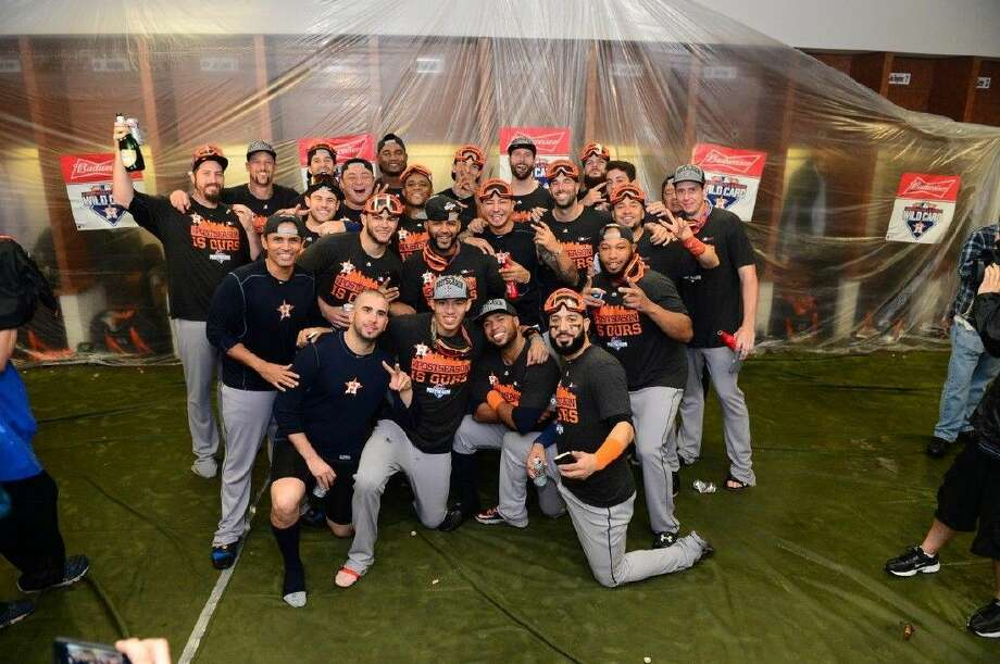 The Astros celebrate their entrance into the playoffs last week. Tonight, they share a second champagne bath in less than a week with their victory over the Yankees.