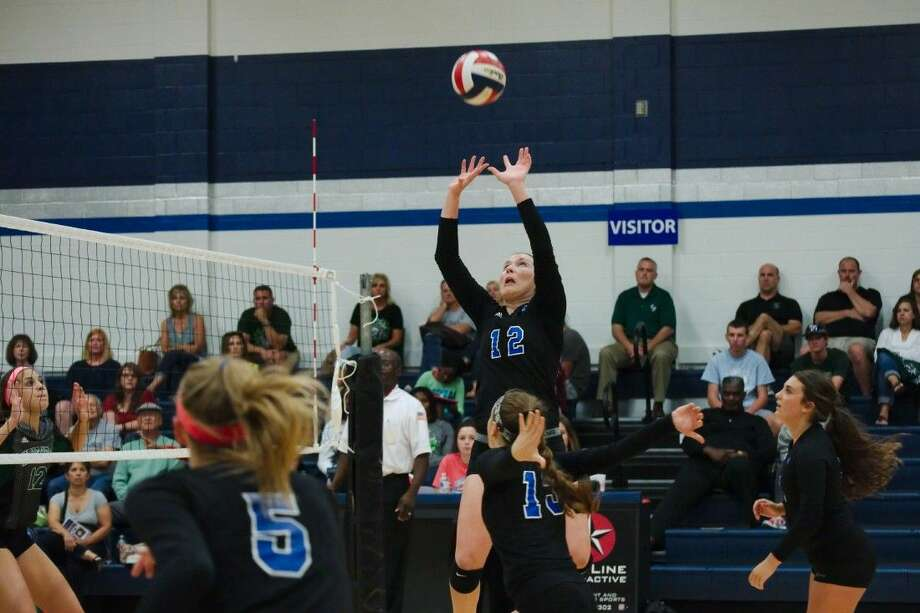 Friendswood's Sarah Thomas (12) sets up a shot against Clear Falls Tuesday in a District 24-6A volleyball match. Photo: KIRK SIDES
