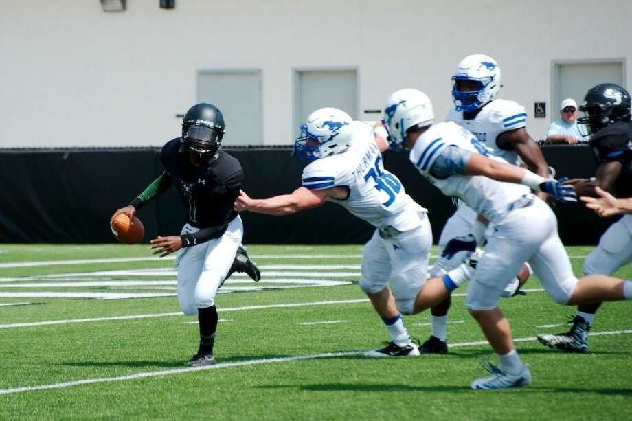 Friendswood's defense will be challenged by a potent Clear Springs offensive attack led by Charger quarterback Will McBride and running back Adrion Smith. Photo: KIRK SIDES