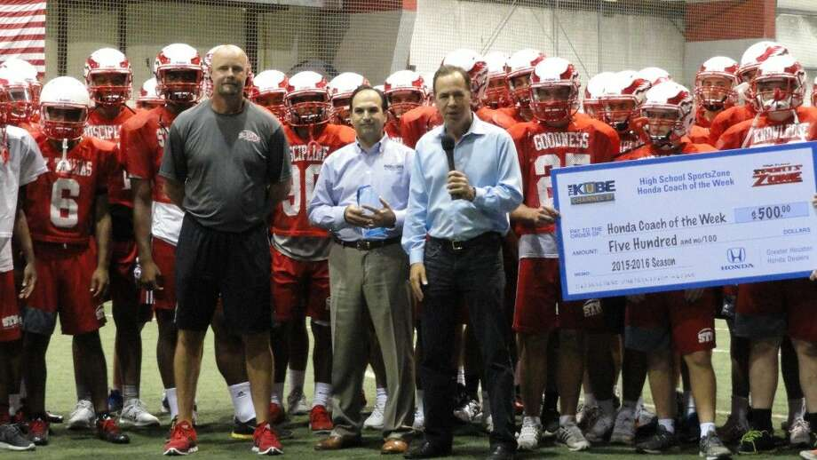 On Sept. 4, St. Thomas High School took to the field at NRG Stadium to go head-to-head against rival Strake Jesuit. St. Thomas' victory that night earned head coach Tim Fitzpatrick the Greater Houston Honda Dealers Coach of the Week award. Jack Varcados, new cars sales director at Russell & Smith Honda, presented Coach Fitzpatrick with a plaque and $500 check for the school's athletic programs. To see highlights from the game, visit http://bit.ly/1P8m6br. Pictured L to R: St. Thomas head coach Tim Fitzpatrick; Jack Varcados, new car sales director, Russell & Smith Honda; and Todd Freed, KUBE High School SportsZone host.