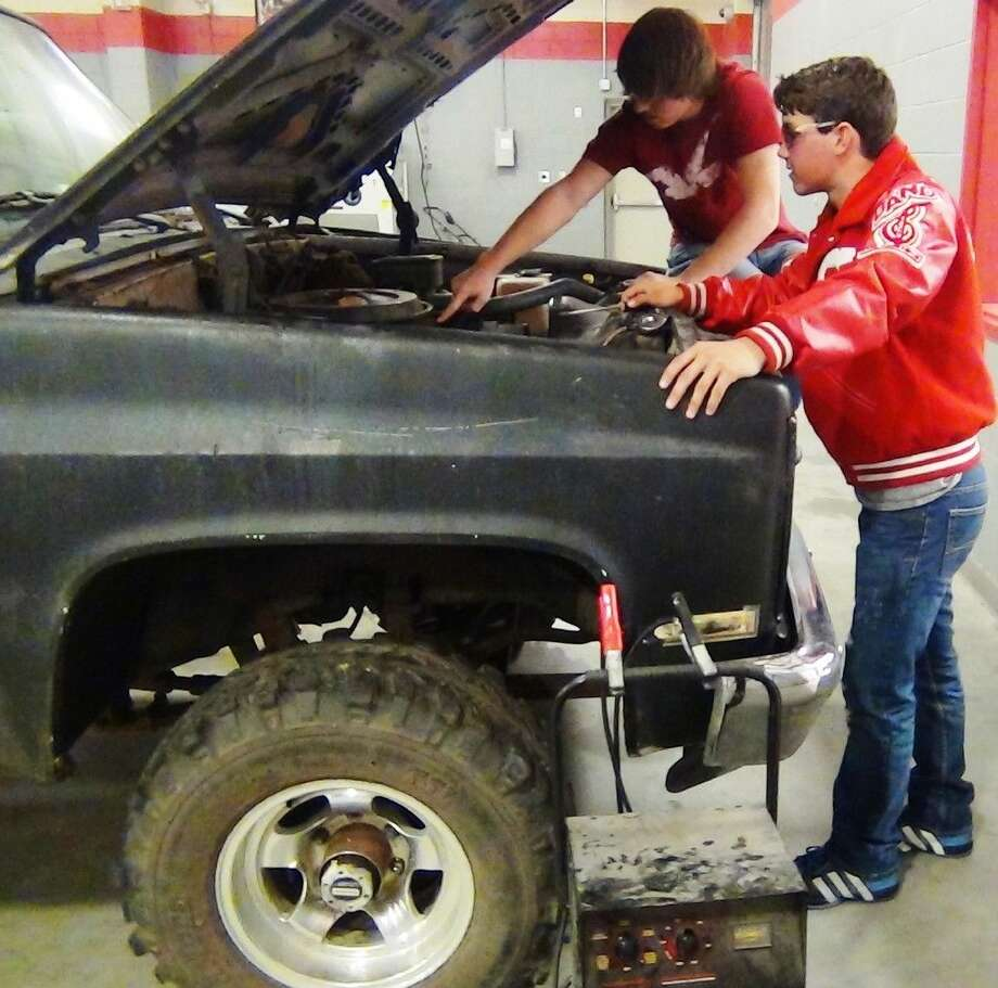 Splendora ISD students in the Auto Mechanics program are offered a unique real-world classroom experience, which could help them in pursuing a career in the field after high school. Photo: Stephanie Buckner