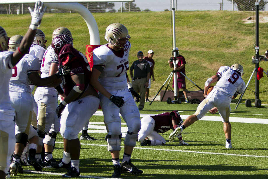 Nick Hooper scores on a 6-yard touchdown run in overtime for Cy Woods on Saturday at Pridgeon Stadium. The Wildcats defeated Cy-Fair, 38-31. Photo: Don Carson/CarsonActionPhoto.com