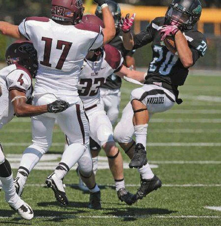 Memorial running back Ricky Hambright spins around the Pearland defender for a few more yards Saturday. Photo: Kar B Hlava