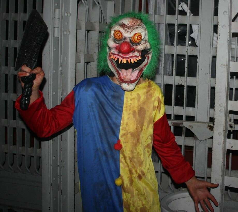 A deranged clown (performed by Justin Glass) lurks on the second floor of the Haunted Jail Museum. Photo: Jacob McAdams