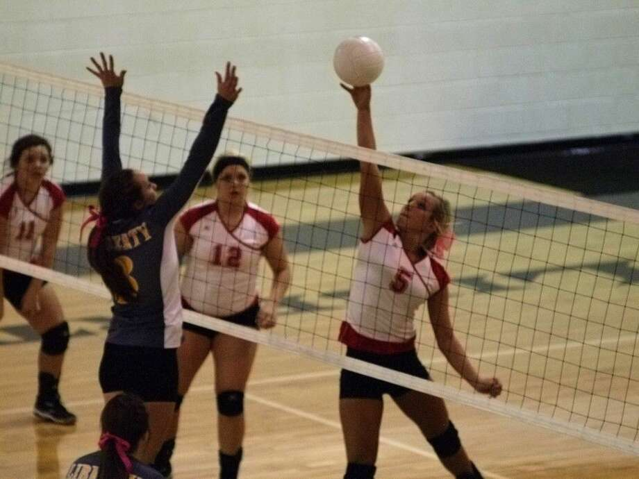Splendora's Briana Helms attacks against Liberty, Oct. 24. Photo: Casey Stinnett