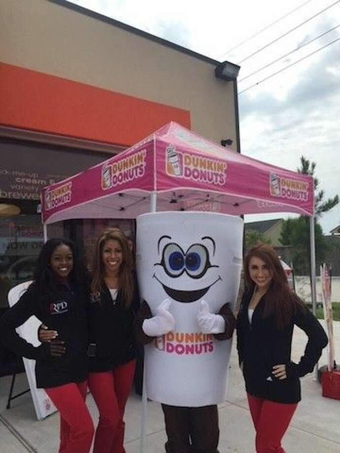 The Rockets Power Dancers and Cuppy.