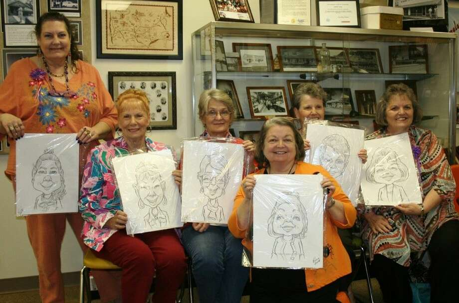 Members of the Magnolia District Woman's Club showed off caricatures drawn by an artist during the Oct. 22 meet and greet event at the Cleveland Historical Museum. Photo: Stephanie Buckner