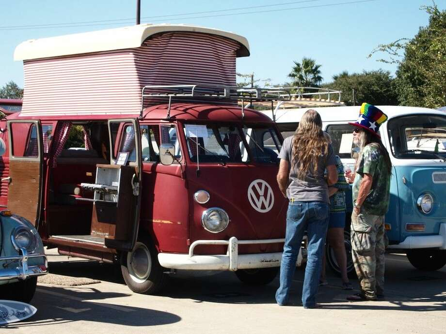 At least one long row of Volkswagens in the community center parking lot had a '60s theme going during Saturday's Dayton Chamber of Commerce Chili Challenge Car Show, Oct. 25. Photo: Casey Stinnett