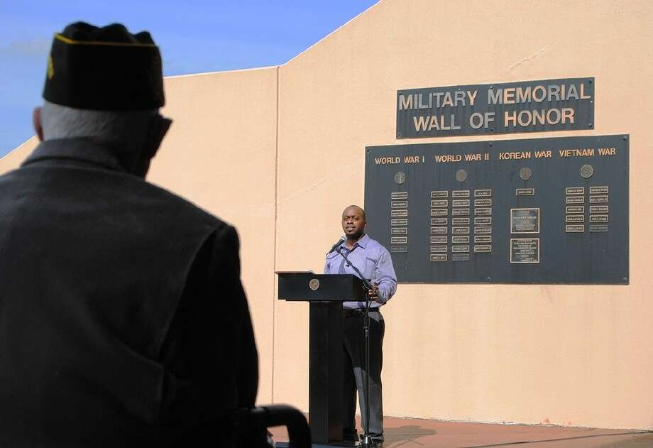 A student veteran talks about his service during a recent ceremony in front of the ACC Memorial Wall.